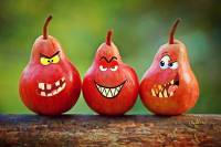 Set of three pears with mean faces