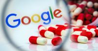red and white capsule pills spilling over a Google logo and a magnifying glass