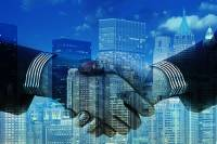 Two business people shaking hands over large office skyscrapers