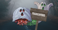 two ghosts of coronaviruses with a sign that says FRANKENFOODS