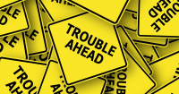 yellow 'Trouble Ahead' signs
