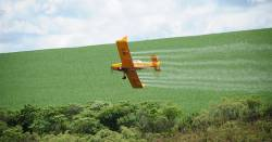 aerial spray of a pesticide or herbicide to an agricultural crop field