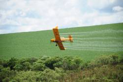 Aerial dispersal of a pesticide over an agricultural field