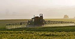 Spraying pesticides on an agricultural farm field