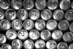Overhead view of many aluminum soda pop cans