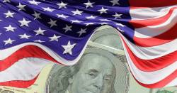 hundred dollar bill hidden beneath the American flag