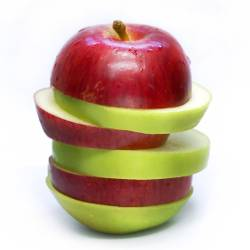 combination of a red and green apple sliced together
