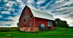 Old red barn under a cloudy sky