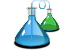 Blue and green liquids in scientific beakers for an experiment