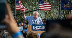 Bernie Sanders speaking at podium at outdoor campaign rally