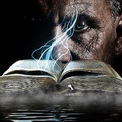 man in front of a smoking book by water