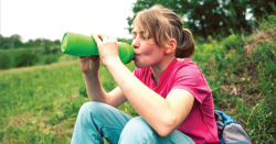 Kid drinking out of plastic bottle.
