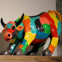 colorful plastic toy of a bull cow steer