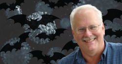 A photograph of epidemiologist Ralph Baric over a black background with bats and microscopic images of a virus