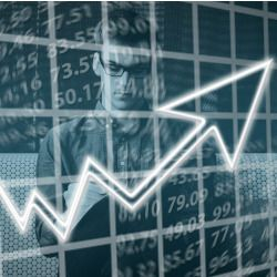 business man standing behind a graph of a chart with an arrow pointing up
