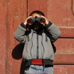 young boy with a pair of binoculars
