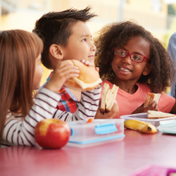 children eating lunch in a cafeteria