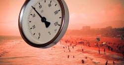 hot day on a red beach with a rising thermometer