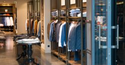rack of mens clothing in a store at a mall