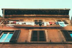 Clothes line with clothes in front of a brick building