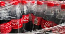 plastic bottles of Coca Cola shipped on pallets