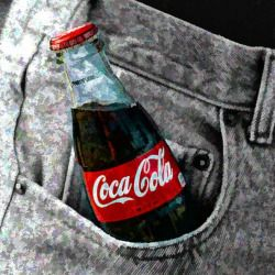 glass bottle of Coca Cola in a front denim pocket