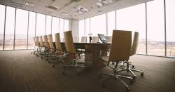 empty chairs around a conference table in a meeting room