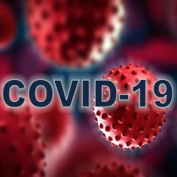 red renderings of corona virus cells with the word COVID19