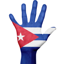 Cuban flag superimposed on an open, raised hand