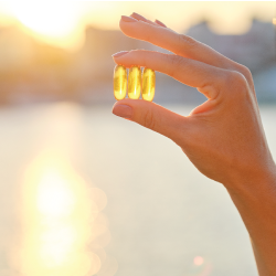 hand holding vitamin d supplements