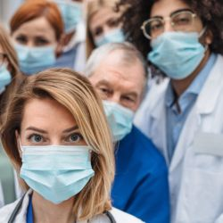 doctors in medical masks and lab coats