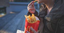 person eating McDonalds french fries