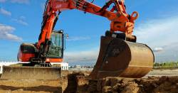 Excavator machine digging during construction