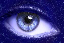 A blue eye surrounded by stars
