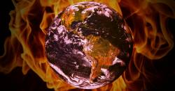 the planet earth surrounded by flames and fire