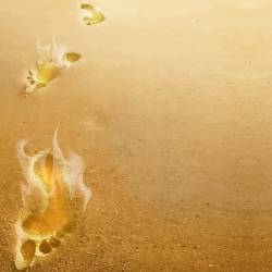 burning and smoking footprints in sand
