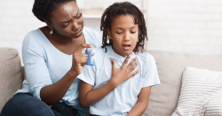 Mother and daughter experiencing asthma.