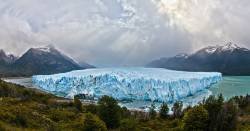 Glacier in a lake at the foothills of a mountain range in Argentina