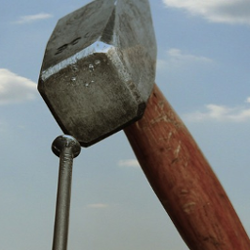 A hammer pounding in a nail