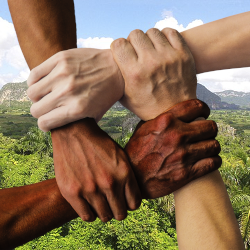 hands united together over a mountain landscape