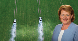 Heidi Heitkamp in front of a field being sprayed with pesticides.