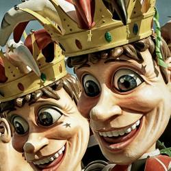 Two jesters with fools masks in a parade
