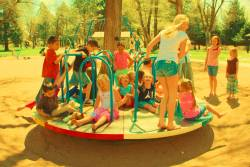 Children playing on a merry go round