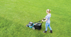 Women mowing the lawn.
