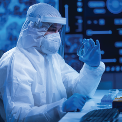 scientist in a hazmat suit in a laboratory doing research on a petri dish