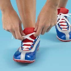 Person tying up blue and red pair of shoes