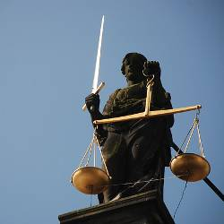 Statue of Lady Justice holding scales and sword