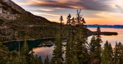 Lake Tahoe in California with mountain at sunset