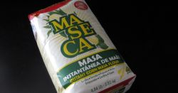 bag of Maseca brand corn flour on a black background
