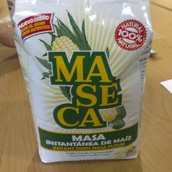 Maseca brand corn flour in a bag on a wooden table